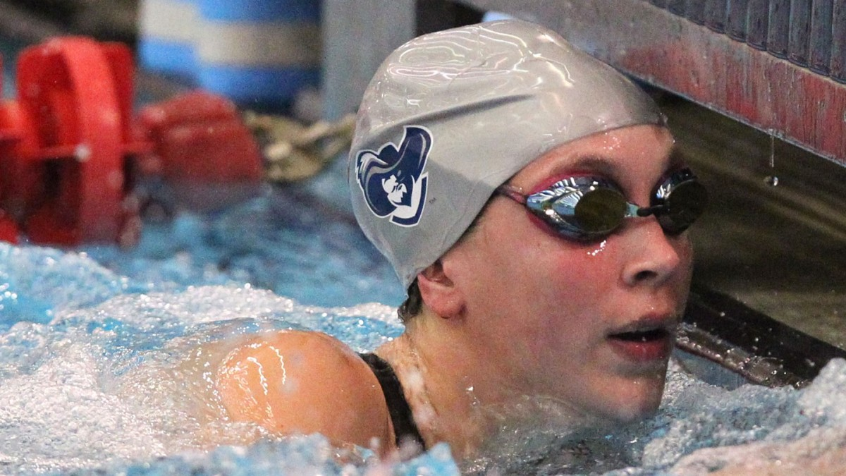 Conners freestyles Xavier to swimming success